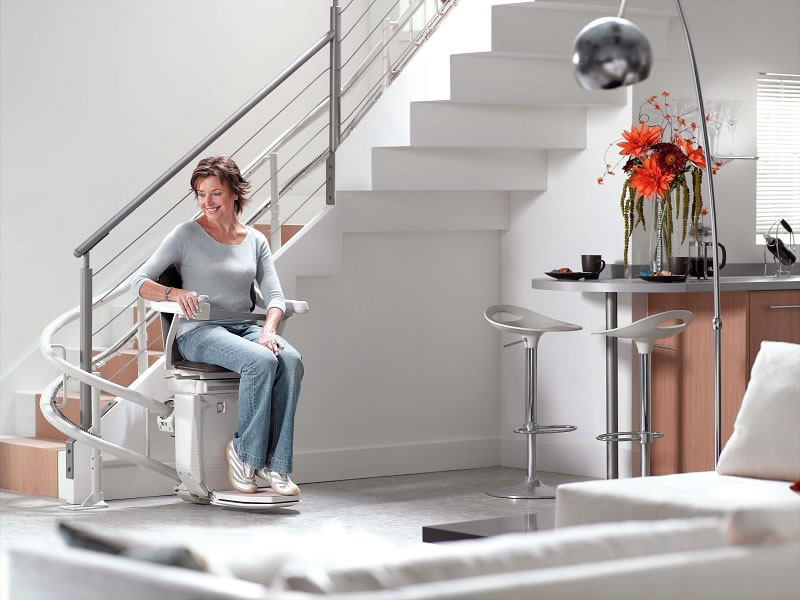 Woman on curved stairlift