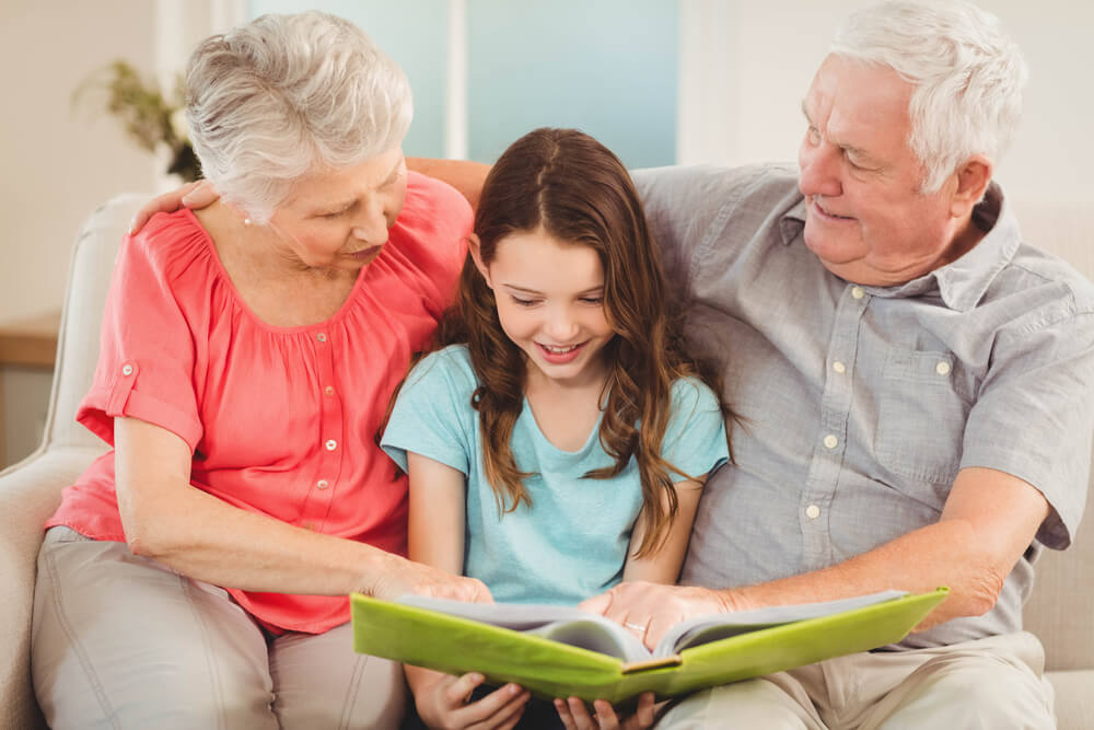 two grandparents teaching child - home mobility aids concept image
